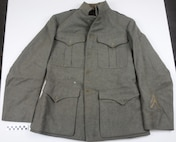 Jacket, wool, part of uniform used by Coast Guard Warrant Officer Cadmus Daniel Griffin, WWI.
