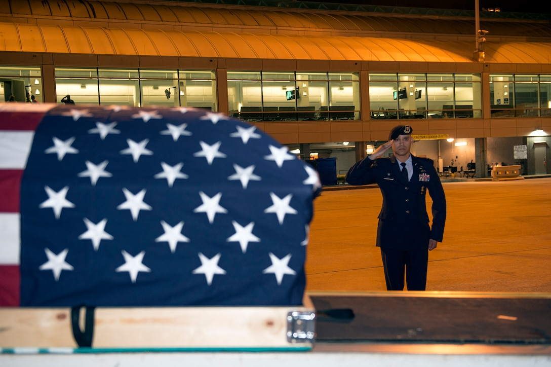 Lt. Col. José Antonio Lebrón, Joint Task Force-Bravo joint security forces commander, Soto Cano Air Base, Honduras, salutes his nephew's, Senior Airman Gabriel Antonio Fuentes Lebrón, 18th Security Forces Squadron, Kadena Air Base, Japan, casket during a dignified arrival in Jacksonville, Fla., May 30, 2017. A dignified arrival is the process by which, upon the return from the theater of operations to the United States, the remains of fallen military members are transferred from an aircraft to a waiting vehicle and then to the port mortuary. Lebrón passed away in Okinawa, May 19. (U.S. Air Force photo by Senior Airman Greg Nash)