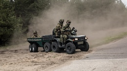 Soldiers of the Norwegian Armed Forces drive through training areas surrounding Camp Adazi, Latvia, during preparation for Exercise Saber Strike 17, June 2, 2017.  Exercise Saber Strike 17 is an annual combined-joint exercise conducted at various locations throughout the Baltic region and Poland. The combined training prepares NATO Allies and partners to effectively respond to regional crises and to meet their own security needs by strengthening their borders and countering threats.