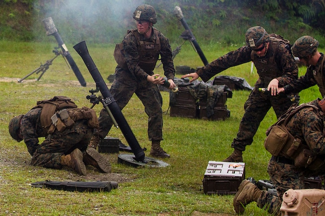 A Marine Corps mortar team prepares to fire an 81 mm mortar during training at Camp Hansen, Okinawa, Japan, May 31, 2017. The Marines are assigned to Weapons Company, Battalion Landing Team, 3rd Battalion, 5th Marines. Marine Corps photo by Staff Sgt. T. T. Parish
