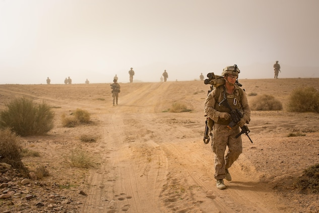 U.S. Marines patrol during a live-fire raid training event, part of Mission Rehearsal Exercise, in southern Jordan Sept. 12, 2016. The MRX is a collective training event where the Marine Air Ground Task Force elements collaborate to refine individual and cooperative capabilities. Marine Corps Systems Command, the acquisition command of the Marine Corps, is realigning its organizational structure to more rapidly equip the MAGTF with information technology and ground weapon systems and equipment. (U.S. Marine Corps photo by Cpl. Trever Statz/Released) - High Resolution Photo