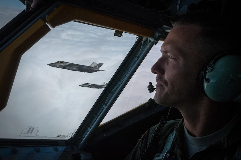 Capt. Matt Davis, 909th Air Refueling Squadron KC-135 Stratotanker pilot, flies in formation with U.S. Marine Corps F-35B Lightning IIs from Marine Fighter Attack Squadron 121, March 14, 2017, over the Pacific Ocean. The training sortie marked the first air refueling mission with F-35s in the 909th ARS's area of operation. (U.S. Air Force photo by Senior Airman John Linzmeier)