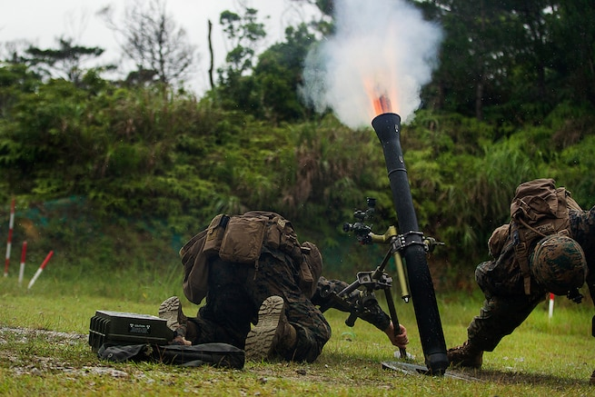 A Marine Corps mortar team fires an 81 mm mortar during training at Camp Hansen, Okinawa, Japan, May 31, 2017. Marine Corps photo by Staff Sgt. T. T. Parish