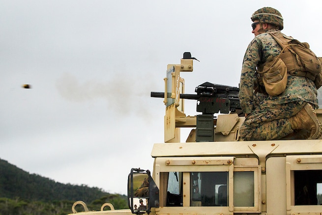 Marines fire a Mark 19 automatic grenade launcher from the turret of a Humvee at Camp Schwab, Okinawa, Japan, June 1, 2017. The Marines are assigned to Weapons Company, Battalion Landing Team, 3rd Battalion, 5th Marines. The Mark 19 is designed to suppress and destroy enemy threats, and fires 40 mm high-explosive grenades at up to 375 rounds a minute. Marine Corps photo by Staff Sgt. T. T. Parish