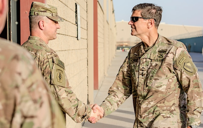 Col. Aaron Stanek (left), commander, 401st Army Field Support Brigade welcomes U.S. Central Command Commanding General, Army Gen. Joseph L. Votel before leading an Army Prepositioned Stocks-5 warehouse tour at Camp Arifjan, Kuwait, June 3. (U.S. Army photo by Justin Graff, 401st AFSB Public Affairs) (Photo Credit: Mr. Justin Graff (Rock Island Arsenal))