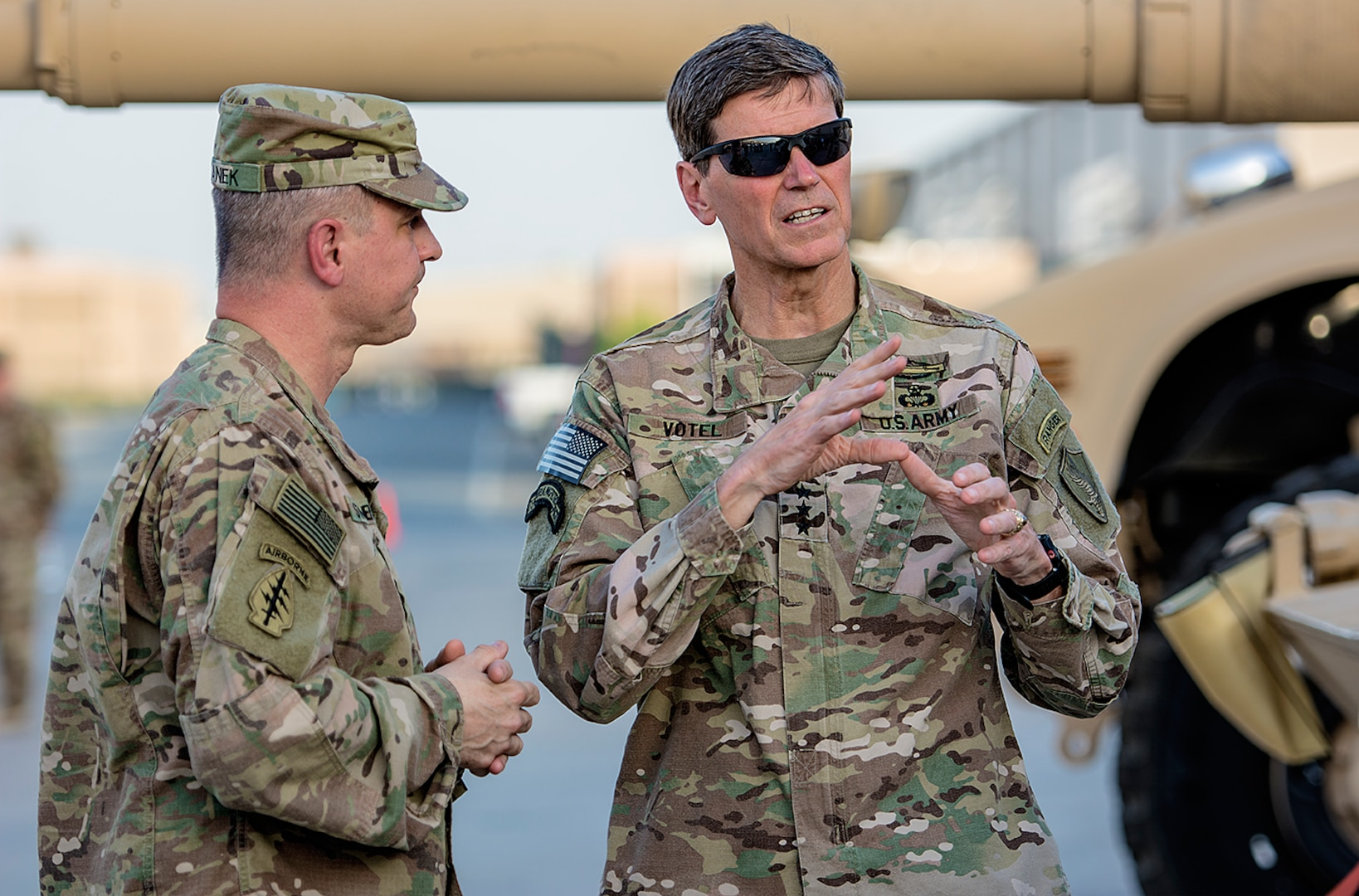 U.S. Central Command Commanding General, Army Gen. Joseph L. Votel (right) discusses maintenance and modernization of Army Prepositioned Stocks-5 heavy equipment with Col. Aaron Stanek, commander, 401st Army Field Support Brigade during a tour of the facility at Camp Arifjan, Kuwait, June 3. (U.S. Army photo by Justin Graff, 401st AFSB Public Affairs) (Photo Credit: Mr. Justin Graff (Rock Island Arsenal))