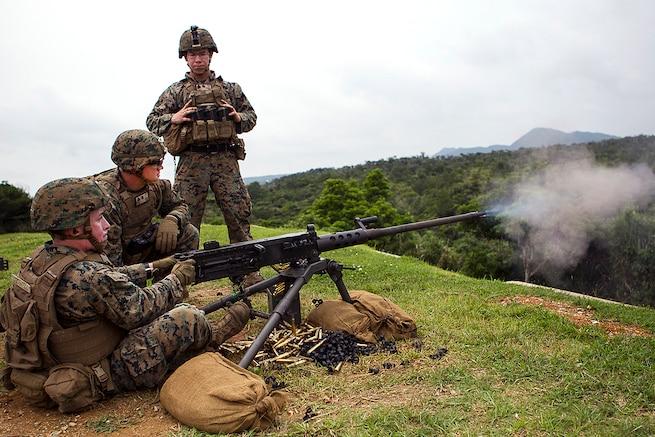 A Marine test fires an M2 .50-caliber Browning machine gun during training at Camp Schwab, Okinawa, Japan, June 1, 2017. Marine Corps photo by Staff Sgt. T. T. Parish