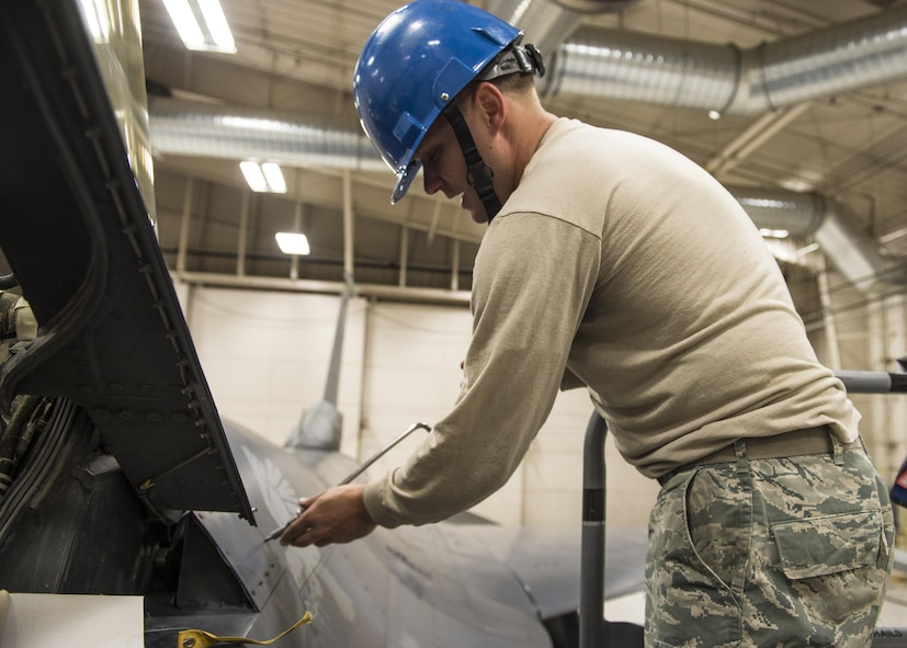 Staff Sgt. Mitchell Lawhorn, a 54th Maintenance Squadron egress systems craftsman, removes an aircraft panel before removing the canopy of an F-16 Fighting Falcon on March 13, 2017 at Holloman Air Force Base, N.M. Egress system specialists ensure that pilots can safely eject from aircraft in the event of an emergency. They perform scheduled and unscheduled maintenance on seats, hatches, canopies and modules to ensure pilots can safely eject if necessary. (U.S. Air Force photo by Senior Airman Emily Kenney)