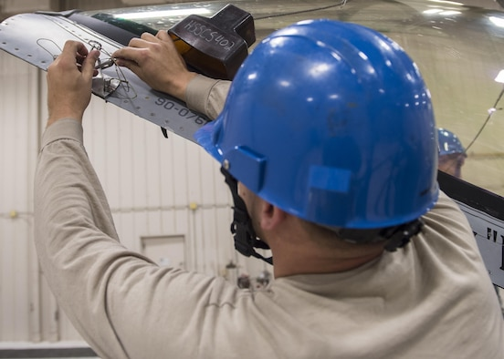 Staff Sgt. Mitchell Lawhorn, a 54th Maintenance Squadron egress systems craftsman, installs a canopy hoist adapter before removing the canopy of an F-16 Fighting Falcon on March 13, 2017 at Holloman Air Force Base, N.M. Egress system specialists ensure that pilots can safely eject from aircraft in the event of an emergency. They perform scheduled and unscheduled maintenance on seats, hatches, canopies and modules to ensure pilots can safely eject if necessary. (U.S. Air Force photo by Senior Airman Emily Kenney)