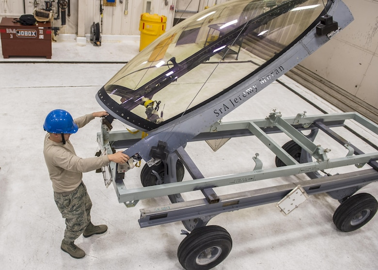Staff Sgt. Mitchell Lawhorn, a 54th Maintenance Squadron egress systems craftsman, removes the canopy of an F-16 Fighting Falcon on March 13, 2017 at Holloman Air Force Base, N.M. Egress specialists work hand-in-hand with Aircrew Flight Equipment to ensure pilots have the necessary equipment in case of an emergency. (U.S. Air Force photo by Senior Airman Emily Kenney)