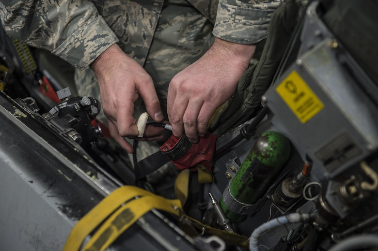 Tech. Sgt. Kevin Mayo, the 54th Maintenance Squadron egress section assistant Non-Commissioned Officer in Charge, removes wiring from an F-16 Fighting Falcon ejection seat on March 13, 2017 at Holloman Air Force Base, N.M. Egress specialists work hand-in-hand with Aircrew Flight Equipment to ensure pilots have the necessary equipment in case of an emergency. (U.S. Air Force photo by Senior Airman Emily Kenney)