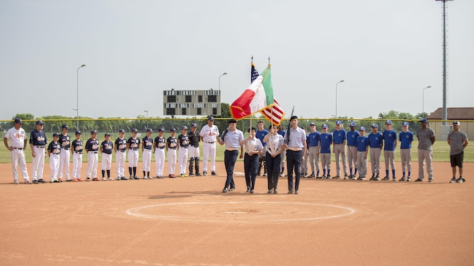The Aviano Tigerz and Junior Alpina baseball teams line up for the American and Italian National Anthems prior to their baseball game June 3, 2017, at Aviano Air Base, Italy. The Aviano Tigerz hosted the Junior Alpina team from Trieste, Italy, in a friendly match that fostered competition and friendship. (U.S. Air Force photo by Senior Airman Cory W. Bush)