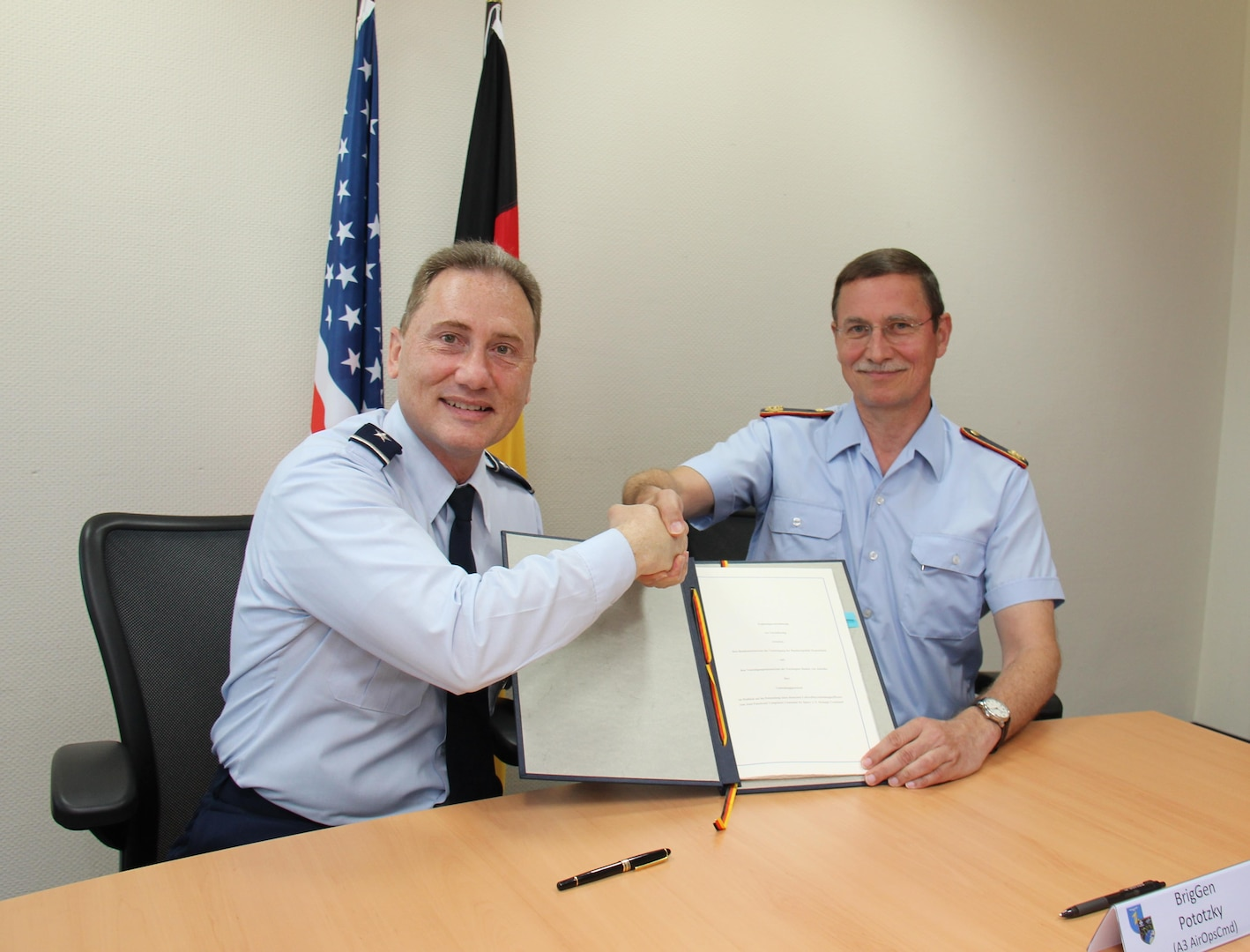 U.S. Air Force Maj. Gen. Clinton Crosier (left), U.S. Strategic Command (USSTRATCOM) director of plans and policy, and German Luftwaffe (air force) Brig. Gen. Burkhart Pototzky, department head and head of the Luftwaffe Operations Center, meet for the signing of a memorandum of agreement (MoA) in Uedem, Germany, June 1, 2017. The MoA authorizes, for the first time, the assignment of a German liaison officer to USSTRATCOM's Joint Functional Component Command for Space under the Multinational Space Collaboration (MSC) effort. The MSC will explore mutual capabilities and identify opportunities for greater integration by co-locating additional allies and partners with U.S. space operators. One of nine Department of Defense unified combatant commands, USSTRATCOM has global strategic missions assigned through the Unified Command Plan that include strategic deterrence, space operations, cyberspace operations, joint electronic warfare, global strike, missile defense, intelligence, and analysis and targeting.