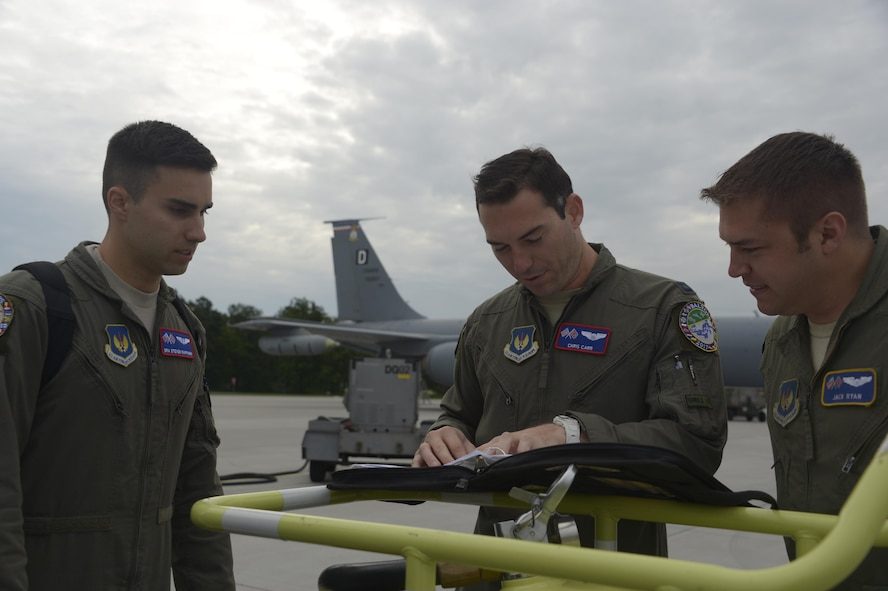 Capt. Chris Carr, center, 351st Air Refueling Squadron pilot, conducts a crew brief with Capt. Jack Ryan, right, 351st ARS co-pilot and Senior Airman Steven Rappuhn, left, 351st ARS boom operator, prior to boarding a KC-135R Stratotanker during BALTOPS exercise at Powidz Air Base, Poland, June 6, 2017. The exercise, is designed to enhance flexibility and interoperability, to strengthen combined response capabilities, as well as demonstrate resolve among Allied and Partner Nations' forces to ensure stability in, and if necessary defend, the Baltic Sea region. (U.S. Air Force photo by Staff Sgt. Jonathan Snyder)