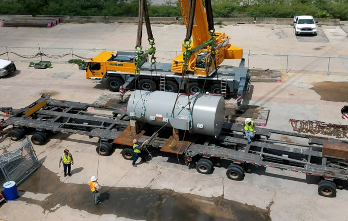 The Reactor Pressure Vessel, secured in its specially designed transport casing, is loaded for delivery to its designated disposal facility. The removal of the RPV marked the removal of approximately 98 percent of the radioactivity on the STURGIS.