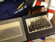 Highlight scrap book from a mixed donation to the Coast Guard Heritage Asset Collection and Archives including uniform, photographs, documents, logbooks, etc.  Coast Guard Museum, Academy, New London, CT.