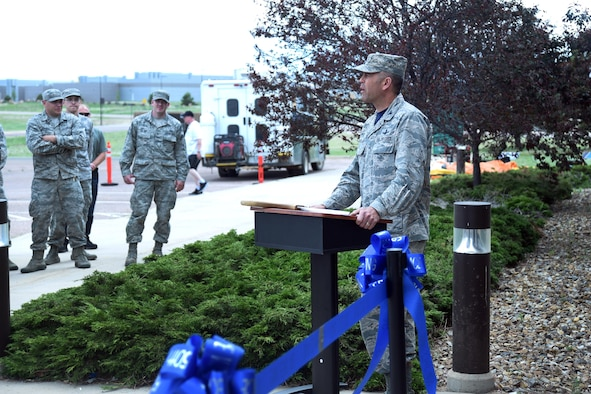 Col. Anthony Mastalir, 50th Space Wing vice commander, addresses the audience during the Schriever event center ribbon cutting ceremony at Schriever Air Force Base, Colorado, Friday, June 2, 2017. Mastalir spoke of the importance of the facility and how it will help bring Airmen together for a place to relax and celebrate. (U.S. Air Force photo/Airman 1st Class William Tracy)