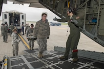 "Capt. Laurie Ann Quiry, 914th Aeromedical Evacuation Squadron, directs members of the 914th Aeromedical Staging Squadron as they load ""patients"" onto a C-130 aircraft as part of a joint service training exercise involving members from other branches of the military. Participants carry out simulated emergency scenarios to gain skills and experience that can be applied to real world situations. (U.S. Air Force photo by Tech. Sgt. Stephanie Sawyer)"