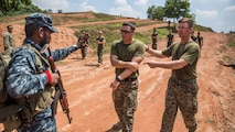 WELISARA NAVAL BASE, Sri Lanka (March 30, 2017) U.S. Marines with Combat Logistics Battalion 11, 11th Marine Expeditionary Unit, acting as simulated disaster victims, approach the entry control point of a humanitarian assistance and disaster relief (HA/DR) camp during HA/DR training at Welisara Naval Base as part of a theater security cooperation engagement, March 30. Working with foreign militaries provides U.S. Marines and Sailors valuable training with warriors from another culture and builds camaraderie between partner nations' militaries. (U.S. Marine Corps photo by Cpl. Devan K. Gowans)