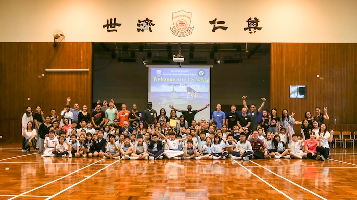 "HONG KONG (April 10, 2017) U.S. Marines and Sailors with the Makin Island Amphibious Ready Group/11th Marine Expeditionary Unit pose for a photo with children from Yan Chai Hospital Law Chan Chor Si Primary School in Hong Kong  as part of a community relations event, April 10. During the event, Marines and Sailors shared stories about ship life, participated in several team games and sang along to ""It's a Small World"" with the children. While visiting various ports, the service members aboard USS Makin Island are given the opportunity to partake in tours, recreational activities, and community relation events to experience the nation's culture. (U.S. Marine Corps photo by Cpl. April L. Price)"