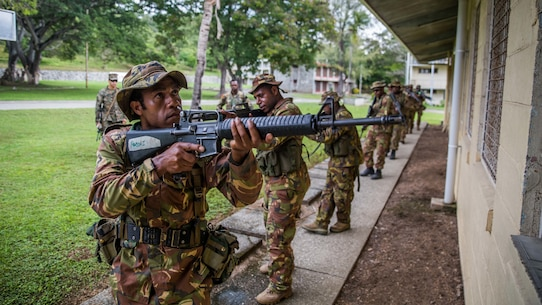 TAURAMA, Papua New Guinea (April 17, 2017) Papua New Guinea Defense Force (PNGDF) service members provide perimeter security while moving past a building during a military tactics exchange conducted alongside U.S. Marines with the 11th Marine Expeditionary Unit at Taurama Barracks as part of a theater security cooperation engagement, April 17. Marines and Sailors embarked aboard USS Comstock (LSD 45) are in Papua New Guinea, focused on increasing military ties with the PNGDF and preparedness for military support to civil authority roles. (U.S. Marine Corps photo by Cpl. Devan K. Gowans)