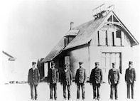 Photograph, the crew of the Pea Island Life-Saving Station, circa 1890s. Keeper Richard Etheridge is on the left.