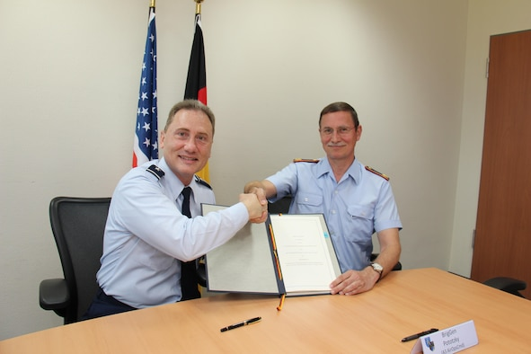 U.S. Air Force Maj. Gen. Clinton Crosier (left), the U.S. Strategic Command (USSTRATCOM) director of plans and policy, and German Luftwaffe (air force) Brig. Gen. Burkhart Prototzky, the department head and head of the Luftwaffe Operations Center, meet for the signing of a memorandum of agreement in Uedem, Germany, June 1, 2017. The MoA authorizes, for the first time, the assignment of a German liaison officer to USSTRATCOM's Joint Functional Component Command for Space under the Multinational Space Collaboration  effort. The MSC will explore mutual capabilities and identify opportunities for greater integration by colocating additional allies and partners with U.S. space operators.