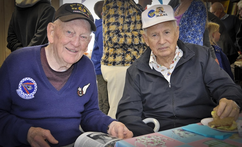 "1st Lt. John ""Des"" Howarth and Maj. Rafael ""Raf"" Ramos, 36th Bombardment Squadron veterans, pose for a photo during a Royal Air Force 100 Group Association Reunion luncheon May 13, 2017 at the City of Norwich Aviation Museum, England. Ramos and Howarth provided early, electronic warfare support to bomber aircraft during World War II. (Courtesy Photo)"