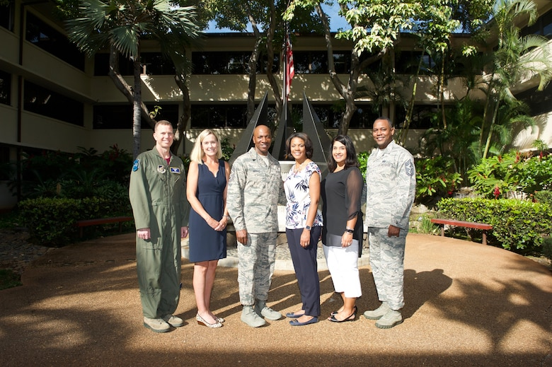 Chief Master Sgt. of the Air Force Kaleth O. Wright (center) and his wife Tonya, pose for a group photo with Pacific Air Forces (PACAF) leadership during their tour of Headquarters PACAF on Joint Base Pearl Harbor-Hickam, Hawaii, June 2, 2017. The visit is an opportunity for Wright to interact with PACAF Airmen, receive mission briefs and views on key issues across the PACAF area of responsibility. (U.S. Air Force photo/Tech. Sgt. Kamaile Chan)