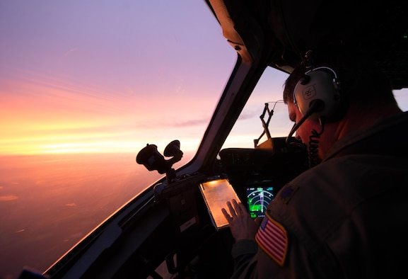 U.S. Air Force Lt. Col. Matthew Yaun, a pilot assigned to the 300th Airlift Squadron, conducts aerial operations during a training flight onboard a C-17 Globemaster III near Joint Base Charleston, S.C., Sept. 8, 2014. Training flights are vital to the operational success of Air Force personnel because they help develop the necessary skills for combat and humanitarian missions. (U.S. Air Force photo by Tech. Sgt. Barry Loo/released)