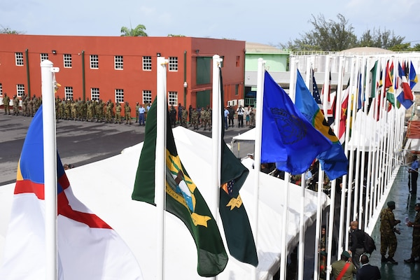 Different countries' flags are shown during the opening ceremony for Tradewinds 2017 in Bridgetown, Barbados, June 6, 2017.  Tradewinds is a joint, combined exercise conducted in conjunction with partner nations to enhance the collective abilities of defense forces and constabularies to counter transnational organized crime, and to conduct humanitarian/disaster relief operations. (U.S. Coast Guard photo by Petty Officer 1st Class Melissa Leake/Released)