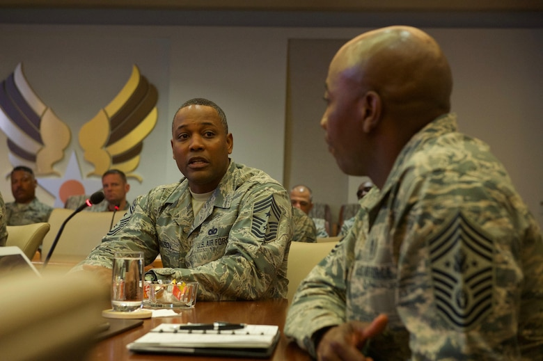 U.S. Air Force Chief Master Sgt. Anthony W. Johnson (left), Command Chief Master Sergeant of Pacific Air Forces (PACAF), speaks with Chief Master Sgt. of the Air Force Kaleth O. Wright during a mission brief at Headquarters Pacific Air Forces on Joint Base Pearl Harbor-Hickam, Hawaii, June 2, 2017. The visit is an opportunity for Wright to interact with PACAF Airmen, receive mission briefs and views on key issues across the PACAF area of responsibility. (U.S. Air Force photo/Tech. Sgt. Kamaile Chan)