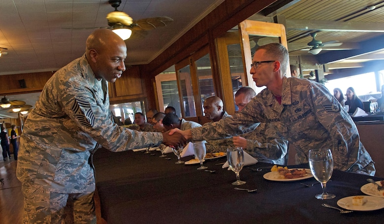 Chief Master Sgt. of the Air Force Kaleth O. Wright (left) greets Staff Sgt. Justin Miranda, Headquarters Pacific Air Forces training manager, during a luncheon at Joint Base Pearl Harbor-Hickam, Hawaii, June 2, 2017. Wright was accompanied by Chief Master Sgt. Anthony W. Johnson, PACAF command chief, and made several stops across the base, providing an opportunity for Airmen to interact with him and discuss their concerns. (U.S. Air Force photo/Tech. Sgt. Kamaile Chan)