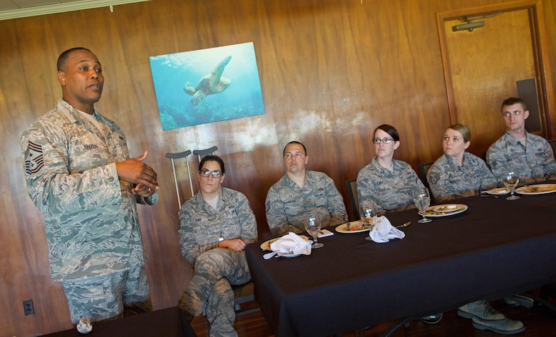 U.S. Air Force Chief Master Sgt. Anthony W. Johnson, Pacific Air Forces (PACAF) command chief speaks with Airmen during a luncheon at Joint Base Pearl Harbor-Hickam, Hawaii, June 2, 2017. Johnson accompanied Chief Master Sgt. of the Air Force Kaleth O. Wright during his visit to PACAF where they made several stops to units across the base, providing an opportunity for Airmen to interact with him and discuss their concerns.  (U.S. Air Force photo/Tech. Sgt. Kamaile Chan)