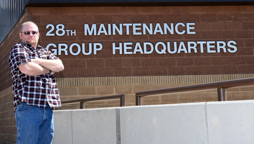 Gregory Carter, the Air Force Repair Enhancement Program manager assigned to the 28th Maintenance Group, stands in front of the 28th MXG Head Quarters at Ellsworth Air Force Base, S.D., March 31, 2017. As the AFREP Program manager, Carter has help the 28th Bomb Wing save more than $34 million over the past decade he has spent with the group. (U.S. Air Force photo by Airman 1st Class Donald C. Knechtel)