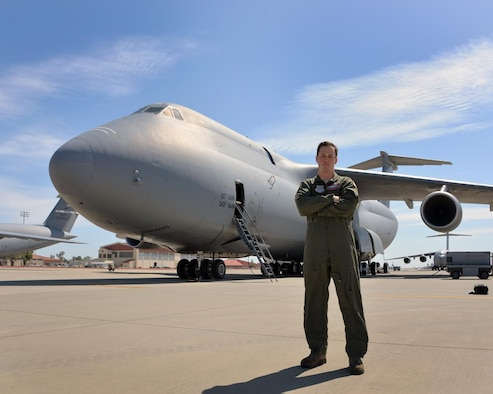 U.S. Air Force Staff Sgt. Oliver Broadbent, 22nd Airlift Squadron loadmaster, poses for a photo in front of a C-5M Super Galaxy June 6, 2017, at Travis Air Force Base, Calif. After overcoming Follicular non-Hodgkin lymphoma, it took nine additional months to regain his qualification and flying status as an Air Force loadmaster. (U.S. Air Force photo by Staff Sgt. Charles Rivezzo)