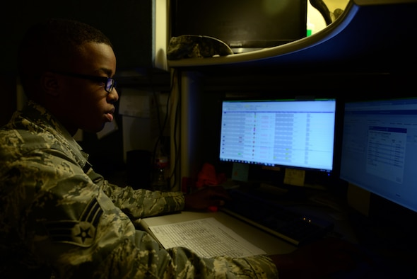 U.S. Air Force Senior Airman Tony Hinton, 58th Airlift Squadron Aviation Recourse Management journeyman, checks Airmen qualifications for in-flight training, June 1, 2017, at Altus Air Force Base, Oklahoma. The SARM office is in charge of approving the accuracy of flight scheduled personnel and documenting their flight records.