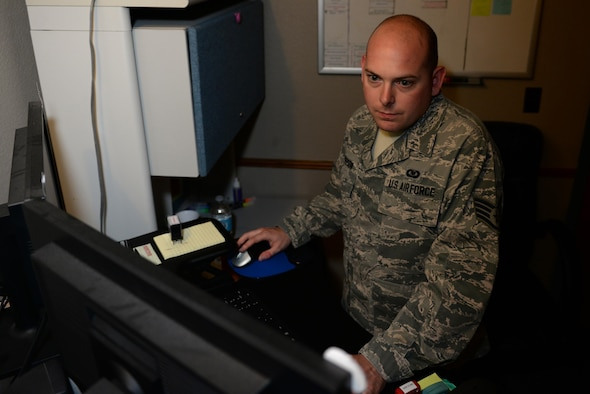 U.S. Air Force Staff Sgt. Nicholas Everson, 58th Airlift Squadron Aviation Recourse Management journeyman, sets up flight orders for the next day's flight, June 1, 2017, at Altus Air Force Base, Oklahoma. The SARM office is in charge of approving the accuracy of flight scheduled personnel and documenting their flight records.