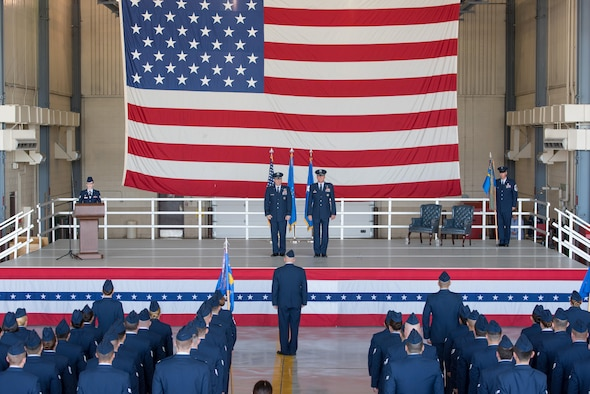 Maj. Gen. Christopher Bence, the United States Air Force Expeditionary Center commander, left, presents Col. Benjamin Spencer, right, to the members of the 319th Air Base Wing as their new wing commander during an Assumption of Command ceremony held June 6, 2017, at Grand Forks AFB, N.D. This will be Spencer's first wing-level command experience. (U.S. Air Force photo by Master Sgt. Eric Amidon)