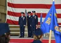 Maj. Gen. Christopher Bence, U.S. Air Force Expeditionary Center commander, left, and Col. Benjamin Spencer, 319th Air Base Wing commander, right, stand in preparation to pass the 319 ABW guidon. Chief Master Sgt. Brian Thomas, 319 ABW command chief, center, provided the guidon for the symbolic exchange during the wing Assumption of Command ceremony June 6, 2017, on Grand Forks Air Force Base, N.D. Spencer and Thomas bring a two-year working relationship to the wing as they take over leading the Warriors of the North. (U.S. Air Force photo by Senior Airman Ryan Sparks)