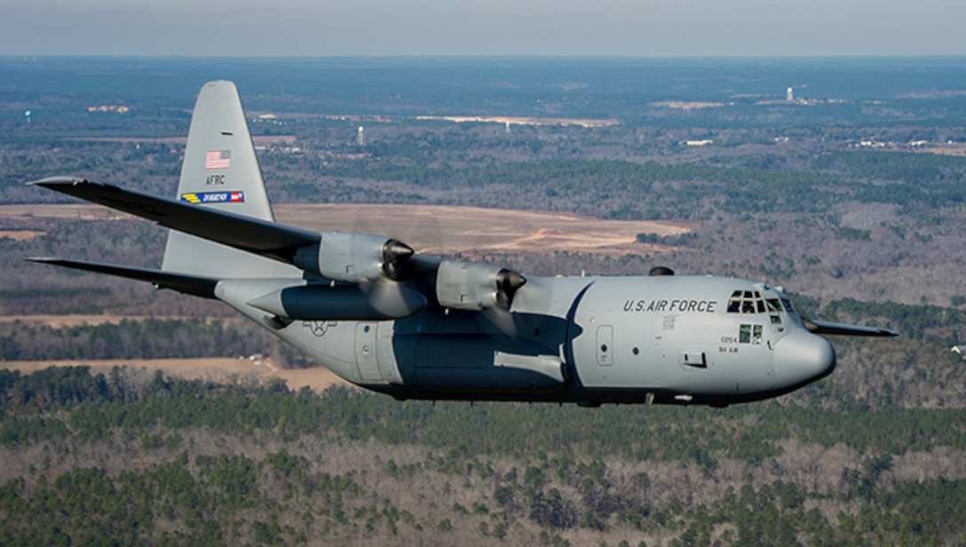 A 94th Airlift Wing C-130 Hercules cruises over North Georgia during a training exercise at Dobbins Air reserve Base, Georgia Dec. 19, 2013. (Photo by Tony Granata)
