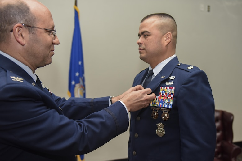 U.S. Air Force Maj. Pedro Jimenez, 17th Security Forces Squadron Commander, receives a Meritorious Service medal during the 17th SFS Change of Command ceremony at the Event Center on Goodfellow Air Force Base, Texas, June 5, 2017. Jimenez received the medal for outstanding service. (U.S. Air Force photo by Airman 1st Class Chase Sousa/Released)