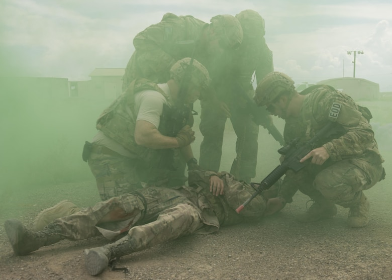 Explosive Ordnance Disposal Airmen assess a simulated casualty during a Tactical Combat Casualty Care exercise at Holloman Air Force Base, N.M., on April 31, 2017. The training focuses on individual trauma, tools, techniques, and treatment procedures. The exercise also included the use of moulage, non-lethal training munitions, trained role-players, and a multitude of other artificial stressors. (U.S. Air Force Photo by Senior Airman Chase Cannon)