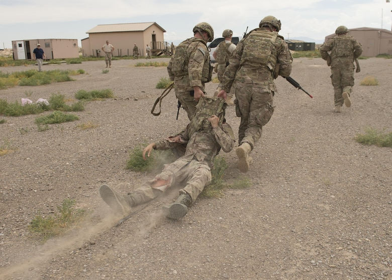 Explosive Ordnance Disposal Airmen extract a simulated casualty during a Tactical Combat Casualty Care exercise at Holloman Air Force Base, N.M., on April 31, 2017. The training focuses on individual trauma, tools, techniques, and treatment procedures. The exercise also included the use of moulage, non-lethal training munitions, trained role-players, and a multitude of other artificial stressors. (U.S. Air Force Photo by Senior Airman Chase Cannon)