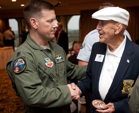 Then Lt. Col. John Martin, commander of the 28th Operations Group, talks with retired Lt. Col. Dick Cole, one of the original Doolittle Raiders during a special event at Fort Walton Beach, Florida, April 19, 2013. Reflecting on the 100th anniversary of two of the original squadrons that participated in the historic raid - the 34th Bomb Squadron and 37th Bomb Squadron - Martin noted the Doolittle Raid is the cornerstones of our bomberheritage. (U.S. Air Force Photo by Senior Airman Carlin Leslie)