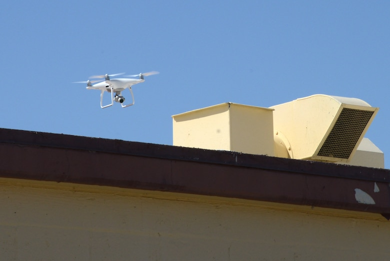 A small unmanned aerial system performs a roof inspection on Building 1401 near the Edwards flightline as part of a series of tests to determine its feasibility as an inspection tool for the 412th Civil Engineer Group. The tests were also flown to evaluate the performance of the aircraft's systems. (U.S. Air Force photo by Christopher Ball)