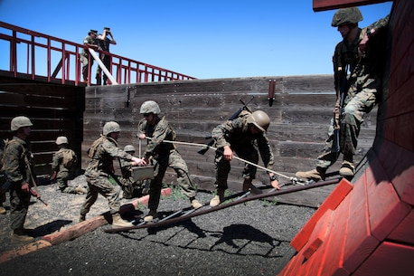 Officer Candidates navigate an obstacle during the leadership reaction course.