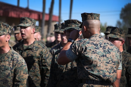 A Drill Instructor instructs an Officer Candidate during the Officer Candidate Annual Pool Function.
