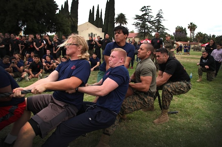 RSS Fontana participates in the tug of war competition during RS Riverside's annual pool function.