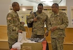 From left to right, Army Brig. Gen. Charles Hamilton, DLA Troop Support commander; Sgt. Maj. Edward Bell, Army G4 senior enlisted advisor; and Lt. Gen. Aundre Piggee, Army deputy chief of staff G4, discuss cold weather boots and other materials that Troop Support's Clothing and Textiles supply chain provides to the Army. Piggee and Bell visited Troop Support in Philadelphia June 5.